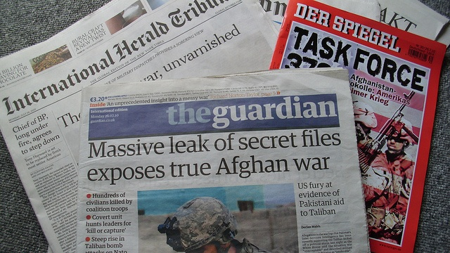 Picture of several European newspapers with Wikileaks-related headlines